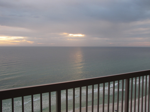 There's a glimpse of the Gorgeous Sunset we watched from our patio during our 1st night in Panama City Beach, FL... nice!! :-)