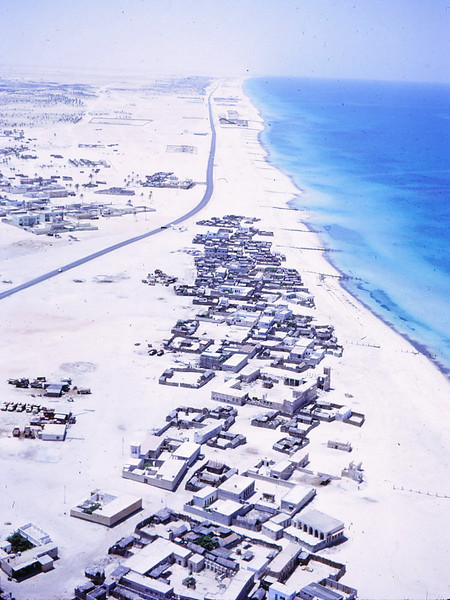 Paved Road from Dubai, running southwest 1.5 miles <br /> to Jumeira Beach in distance where the Dubai Jumeira Mosque is now located.<br /> Dubai-1966