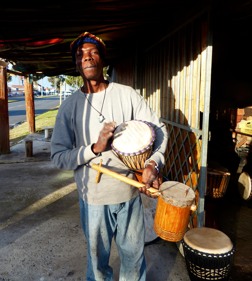 This young man makes drums and played some music for us.