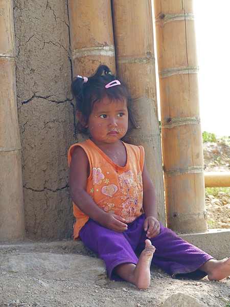 As we walked along the tomb circuit, I was always on the lookout for photos. This little girl was sitting on the porch of a home.