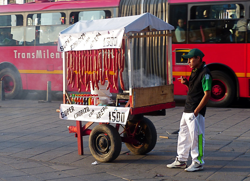 A vendor on a busy street.