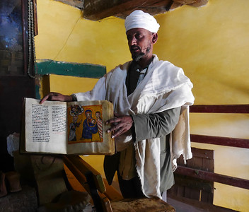 A priest showing us an old manuscript at Yeha. We saw many books like this in Ethiopia.