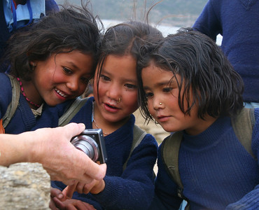 A digital camera brings excitement to school kids in Simikot