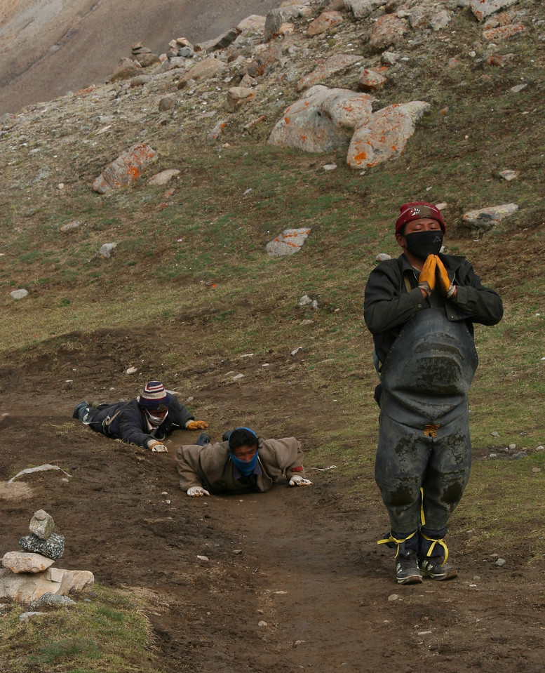 As we preced around the mountain, we see many Tibetans on the same journey. Here are 3 more who circle the entire mountain doing prostrations.