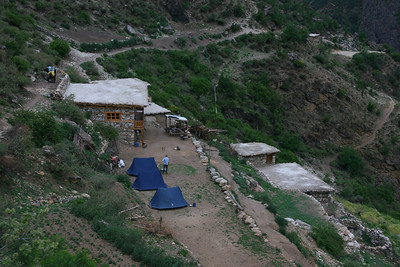 """We are part of a """"full service trek"""". Our team consists of a sirdar (trekking guide), 3 sherpas and 2 drivers to take care of our 4 donkeys, 3 yaks and 2 horses. The 5 of us sleep in 3 tents. We have a kitchen tent and a dining tent, which are not visible in this photo. When we arrive in camp in the evening, our tents are already set up and hot tea is ready. All our meals are prepared for us."""