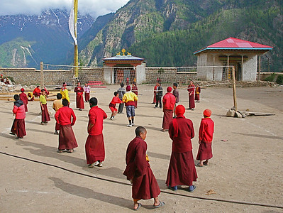 A monastery is located near Yalbang. The young monks play volleyball on their arternoon off.