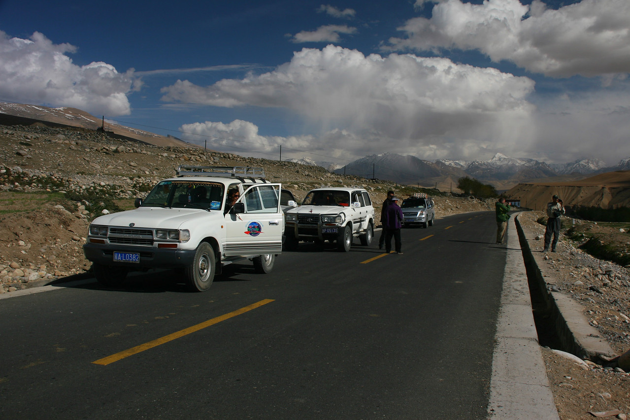 After crossing into Tibet, we are met by our Tibetan Guide, two land rovers, and a truck. Our 3 Sherpas also stay with us. We are surprised to find the roads paved. This happened 2-3 years ago, and makes the driving in Western Tibet much easier.