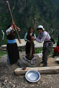 Pounding grain into flour is a task that women in these villages have been doing for centuries. Here we stop in the village of Kermi.