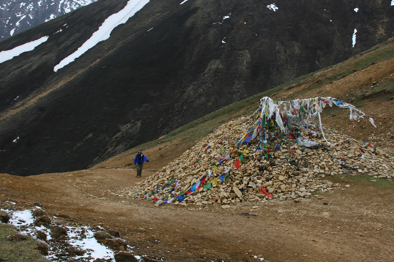 The highest point of the trek from Simikot to Tibet is Nara La at 15,000 feet. Many people add a stone to the pile as they cross.