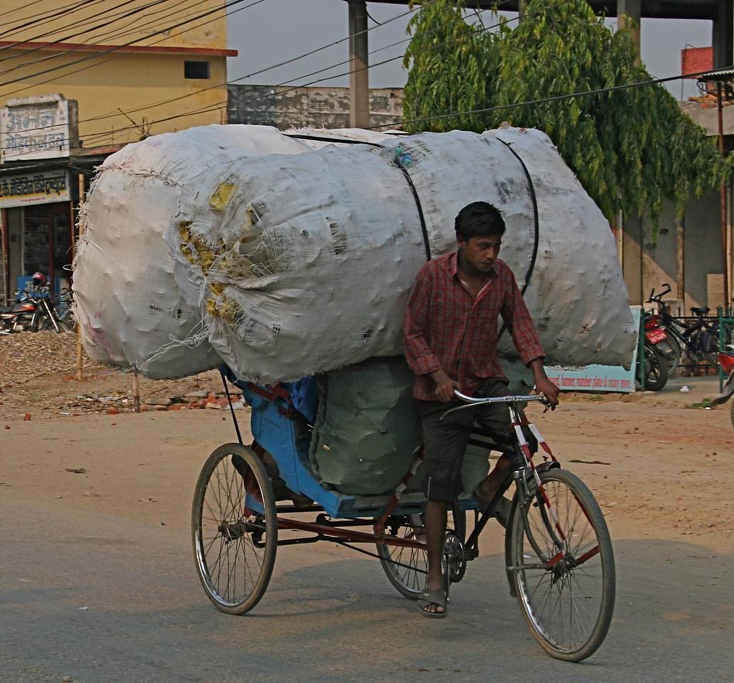 The main street of Nepalgunj. Rickshaws are used for everything.