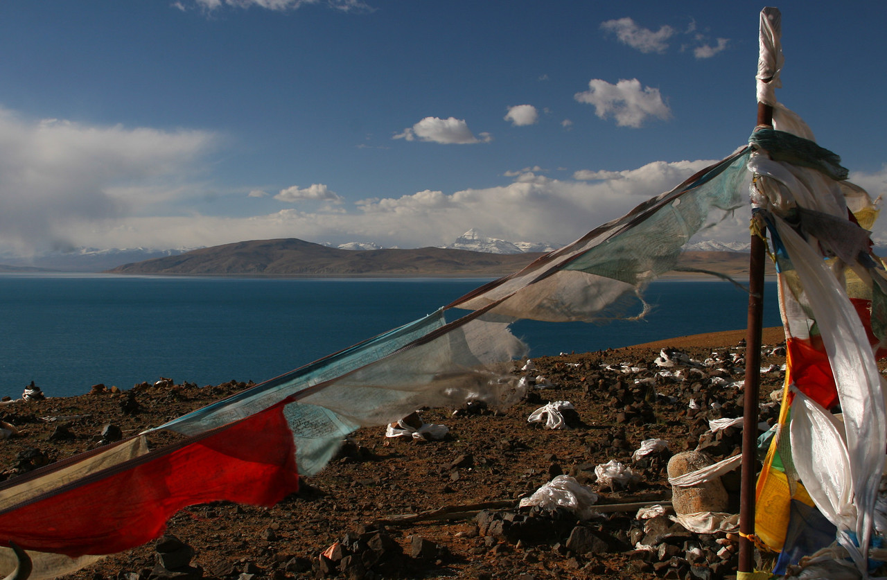 There are many prayer flags around the lake.