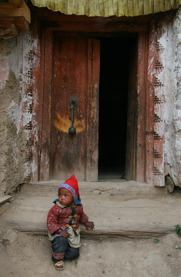 Near Tumkot, we visit a Gompa that was 600 years old. The caretaker's child guards the entrance.