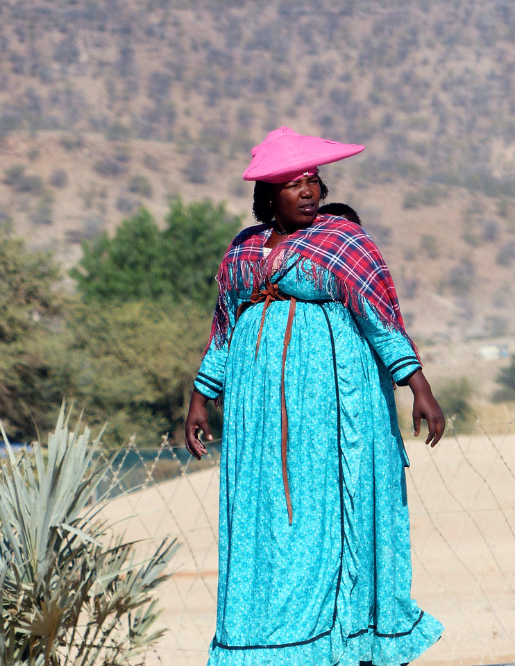 The Herero women's dress is a sharp contrast to the Himba.