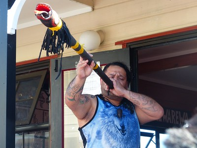 Here a man plays a traditional instrument.