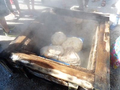 """The village people cook in the natural  """"ovens.""""  Here, chunks of meat are left steaming while the people go to work. When they return home, dinner is ready."""