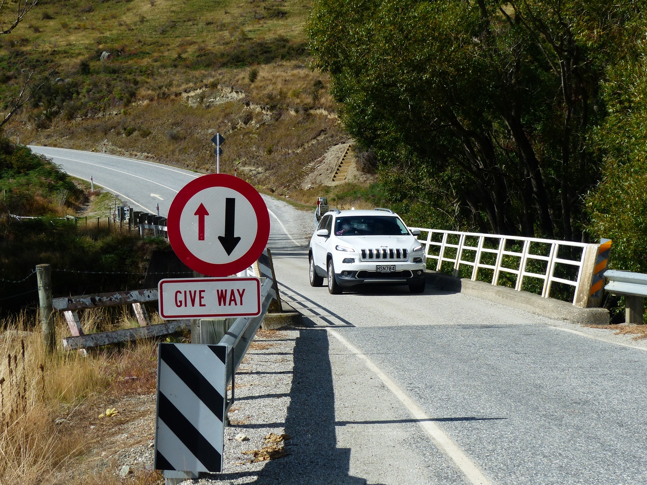 This was a typical New Zealand  highway bridge. Most of the bridges throughout the country had only one lane. The signs indicated who had priority but you always had to make sure someone wasn't coming the other way.