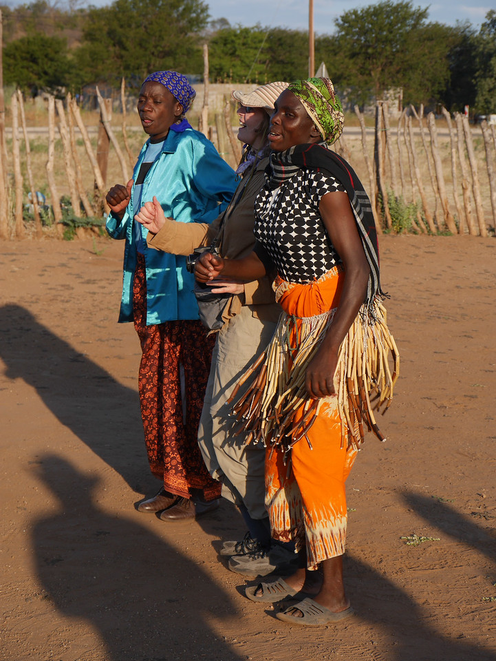 At the basket weaving center in Mabele, we were entertained with dancing and singing. Rena joins in.