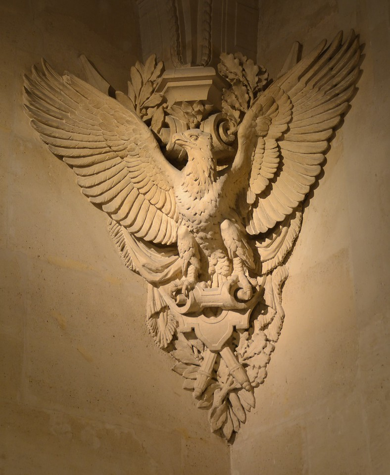 Relief of eagle in a corner of the salle du Manège (Louvre).