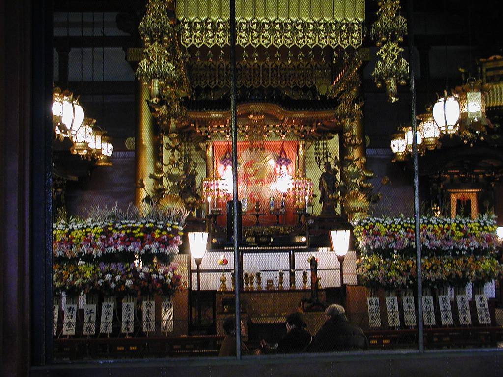 Prayer at senso ji buddhist temple
