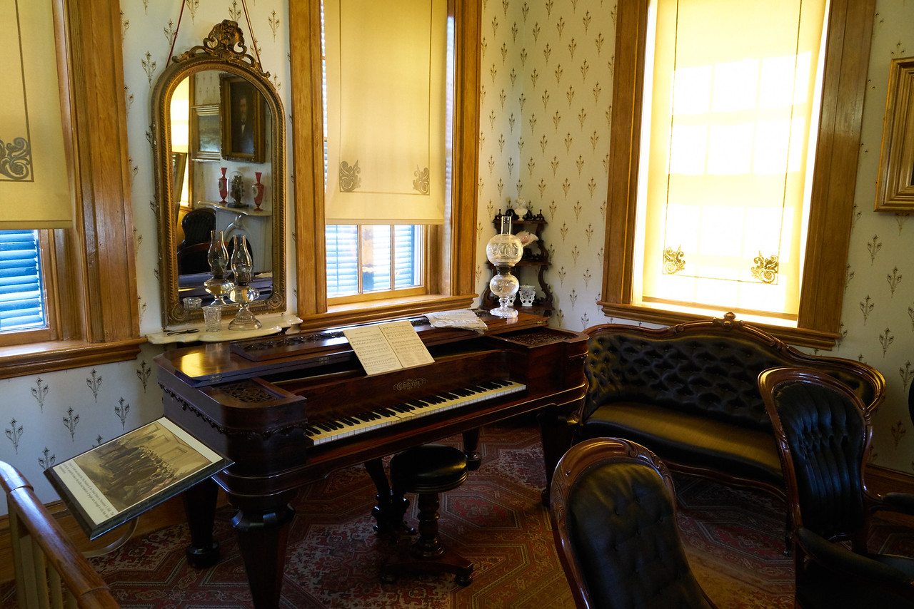 A pianoforte like the one Julia and daughter Nellie would have played.