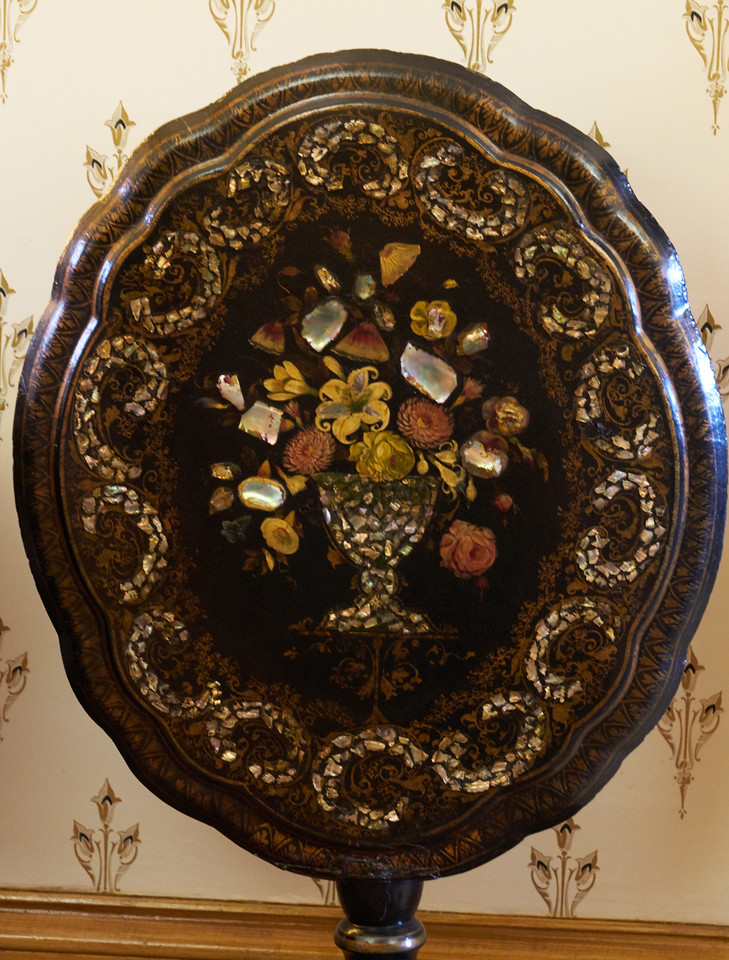 Inlaid tilting table used in the Parlor