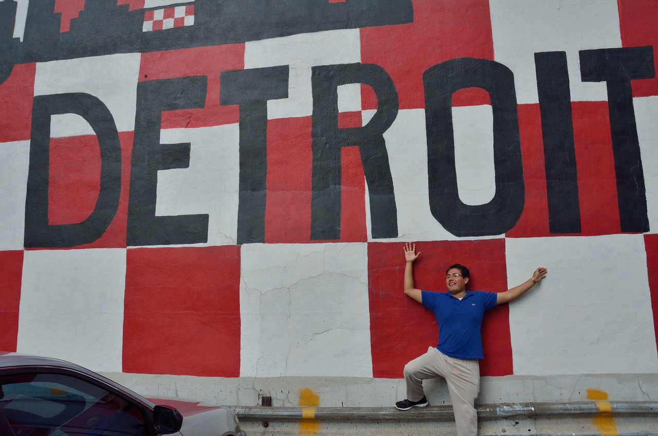 Carlos Antonio Torres Sosa from Mexico poses under wall art on his visit to Detroit.