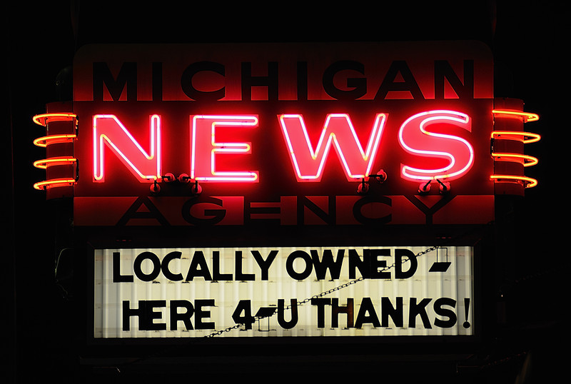 Michigan News Agency Kalamazoo, founded in 1947 by Vincent Malmstrom.  The Michigan News Agency's shelves are packed with 16,000 paperbacks, 6,500 magazines, and stacks of newspapers.