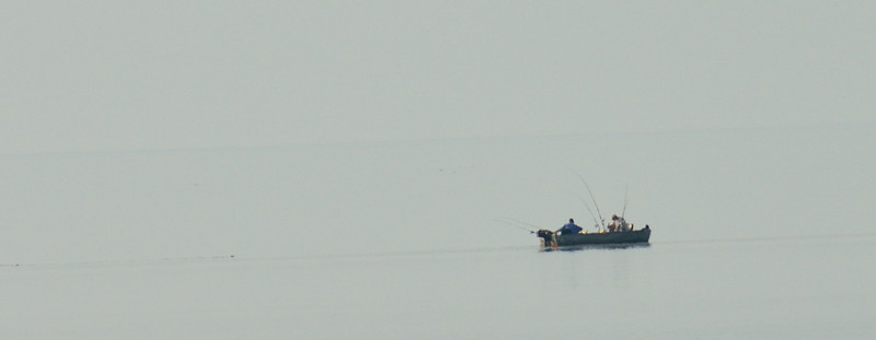 Fishermen on a lonely Lake Michigan.  Sky and Lake melded into one.