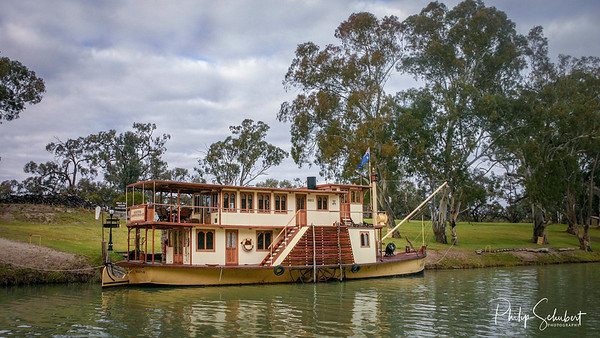 "Waikerie, South Australia - May 5 2005: The historic paddle steamer ""Arkuna Amphibious"" was completely restored and is moored at ""Walker Flat"" on the Murray River near Waikerie in South Australia."