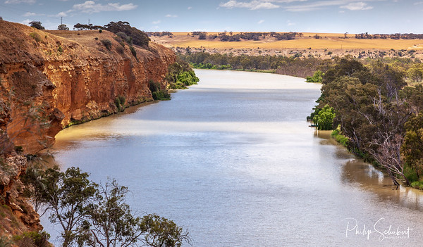 Landscape view of orange sandstone cliffs on the mighty Murray River near Young Husband in South Australia