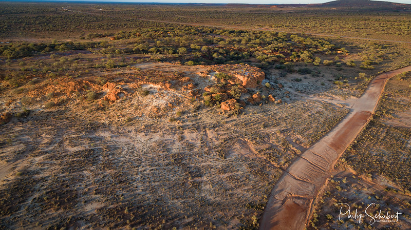 """Aerial view at sunrise of the mesa and buttes at """"The Granites,"""" Mount Magnet, Western Australiabuttes of """"The Granites"""" Mount Magnet, Western Australia"""