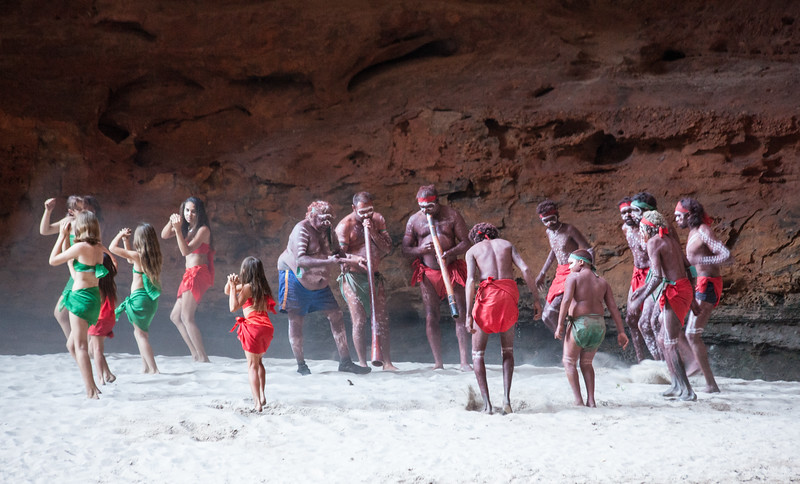 """The """"Karjanarna Jaru"""" indigenous dance group performing a traditional  dance in the natural amphitheatre of Catherdral Gorge in the Bungle Bungles"""