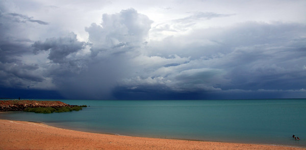 Enjoying a swim and the spectacle of an afternoon thunderstom across Roebuck Bay at Town Beach, Broome