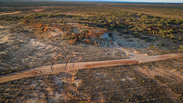 "Aerial view at sunrise of the mesa and buttes at ""The Granites,"" Mount Magnet, Western Australiabuttes of ""The Granites"" Mount Magnet, Western Australia"