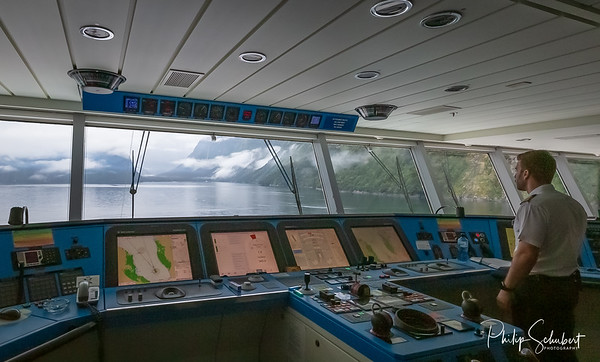"""Milford Sound, New Zealand - Apr 12 2019: The luxury cruise ship """"Celebrity Solstice cruises Milford Sound. 120 cruise ships visit the sound each year."""
