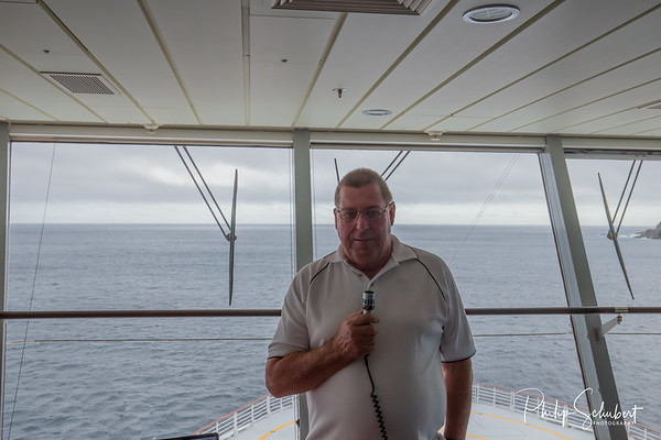 Lecturer on bridge of cruise ship giving commentary on wildlife and natural features of the Sounds in New Zealand.