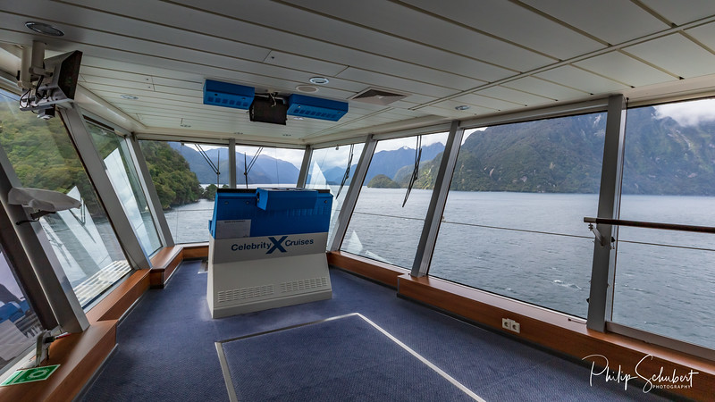 "Milford Sound, New Zealand - Apr 12 2019: The luxury cruise ship ""Celebrity Solstice cruises Milford Sound. 120 cruise ships visit the sound each year."