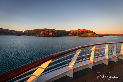 Sunset view of Prince Frederick Harbor in the remote Kimberley coast of Western Australia from the deck of an anchored expedition cruise ship.
