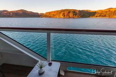 Sunset view of Prince Frederick Harbor in the remote Kimberley coast of Western Australia from a balcony stateroom of an anchored expedition cruise ship.