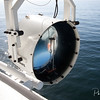 Powerful ship's searchlight against a calm sea background