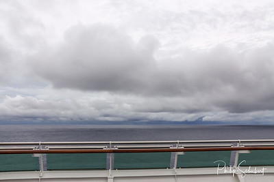View from upper deck of modern cruise ship on a grey stormy day in the Tropics.
