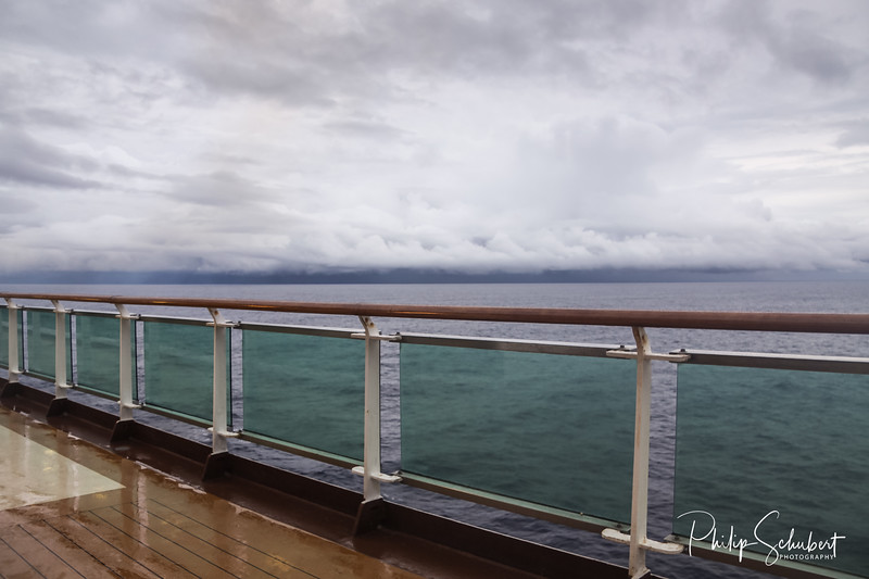 View from upper deck of modern cruise ship on a wet grey stormy day in the Tropics.