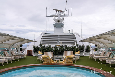 View of Adults Only relaxation and spa area on the upper decks of a modern cruise ship.