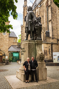 """Leipzig, Germany - May 3, 2019: Tourists have """"selfies"""" at the commemorative statue of the famous composer Johann Sebastian Bach at Thomaskirche where he was a kapellmeister in the 18th century"""