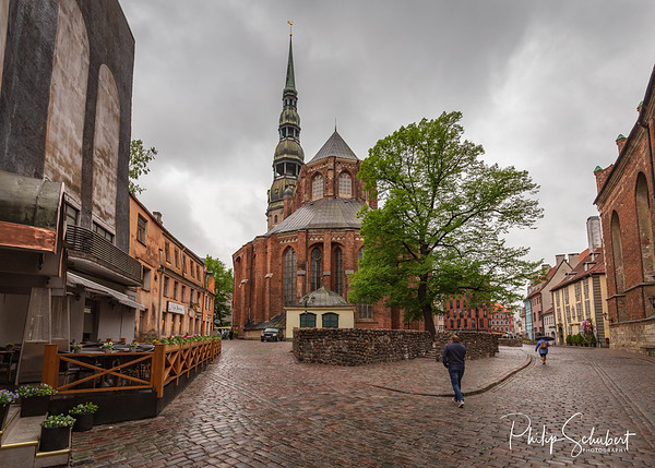 Riga,Latvia - May 13, 2019: Street scenes of Old Town Riga on a cloudy wet day. The city has many delighfully restored buildings.