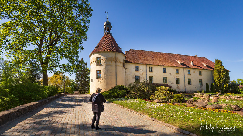 Jaunpils, Latvia -  May 5, 2019: Jaunpils Castle in Latvia ia a medieval castle dating from the 15th Century, now a hotel and museum.