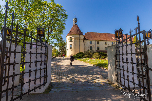 Landscape view of Jaunpils Castle in Latvia on a bright clear Spring day.
