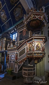 Klepsk, Poland - May 7, 2019: View of the pulpit and baptismal font in the Evangelical Church of the Blessed Virgin Mary. The church was founded in 1367 and is famous for its artworks.