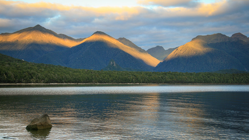 Sunrise on the Alps on the Western shores of Lake Manapouri, New Zealand