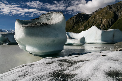 Landscape view of Icebergs in the glacial lake at the foot of the Tasman glacier, Aoraki National Park, New Zealand